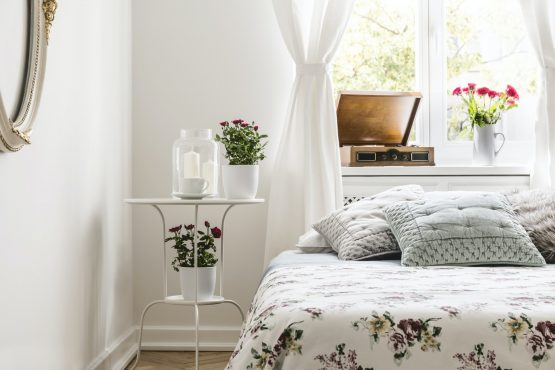 Rose loving woman's bedroom interior with a bed with flower patt