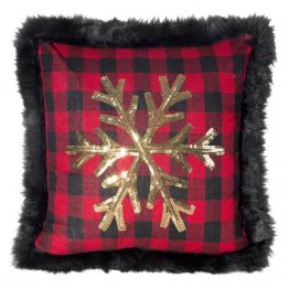Black and red cushion with gold snowflake design