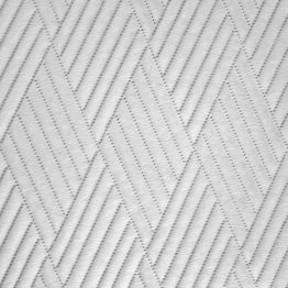 Double sided white quilted velvet bedspread with geometric design
