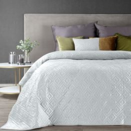 White quilted bedspread with geometric design