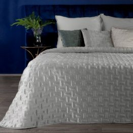 Silver quilted velvet bedspread with geometric design