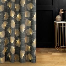 Grey and gold eyelet curtains with ginkgo design